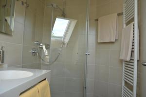 Kylpyhuone majoituspaikassa Hotel Ortel