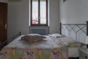 Letto o letti in una camera di Agriturismo La Morosina