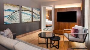 A seating area at The Charter Seattle, Curio Collection By Hilton