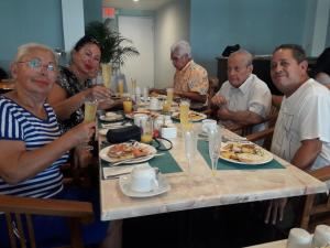 A restaurant or other place to eat at Aruba Harmony Apartments