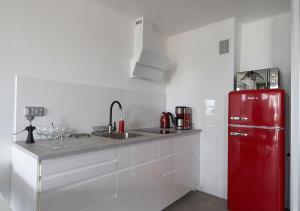 Kuchyň nebo kuchyňský kout v ubytování Aroma Apartments Rondo ONZ