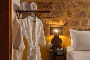 A bed or beds in a room at 10GR Hotel & Wine Bar Rhodes