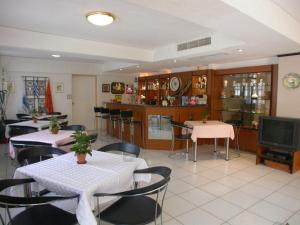 A restaurant or other place to eat at Emily Hotel