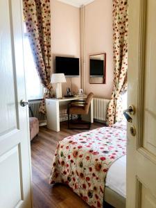 Een bed of bedden in een kamer bij Mare Sanat