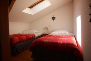 Un ou plusieurs lits dans un hébergement de l'établissement Le Relais du Vermont