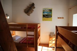 Un ou plusieurs lits superposés dans un hébergement de l'établissement Le Relais du Vermont