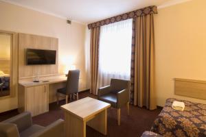 Telewizja i/lub zestaw kina domowego w obiekcie Motel DB2000