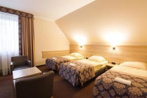 Łóżko lub łóżka w pokoju w obiekcie Motel DB2000