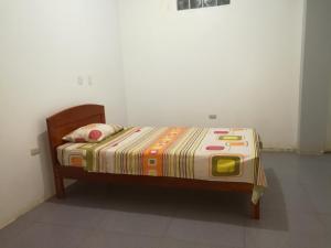 A bed or beds in a room at HOSPEDAJE K & J