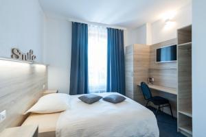 Ein Bett oder Betten in einem Zimmer der Unterkunft Hotel Acacia