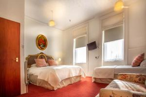 A bed or beds in a room at The Winter Dene