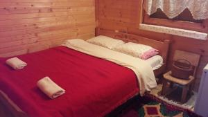 A bed or beds in a room at Karadžić