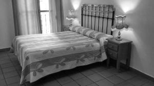 Cama o camas de una habitación en Hostal Altamira Guadalupe