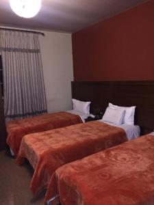 Кровать или кровати в номере Kanaan Group Hotel