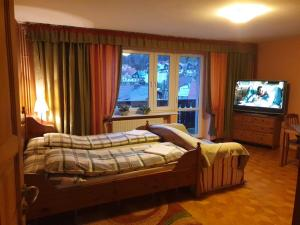 Łóżko lub łóżka w pokoju w obiekcie Pokoje Gościnne CYKADA