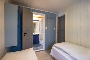 A bed or beds in a room at Svinøya Rorbuer
