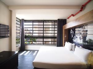 Cama o camas de una habitación en Ben Yehuda Apartments