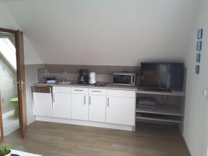 A kitchen or kitchenette at Haus Scheel