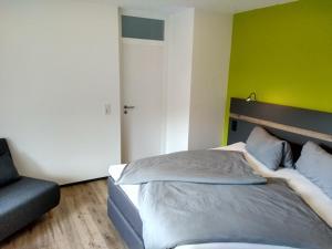 Ein Bett oder Betten in einem Zimmer der Unterkunft Apartment Haus Sembachtal