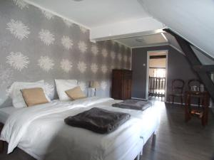A bed or beds in a room at Mazieras