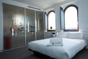 A bed or beds in a room at Hotel Melibea by gaiarooms