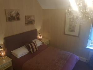 A bed or beds in a room at Haigs Hotel
