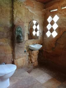 A bathroom at On The Rocks Bungalows & Restaurant