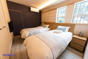 GuestVilla HakoneYumoto RiverSideにあるベッド