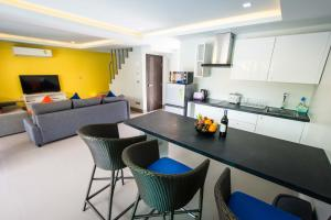 A kitchen or kitchenette at The Pearl Luxury Pool Villas