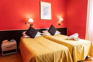 A bed or beds in a room at Hotel Berlino