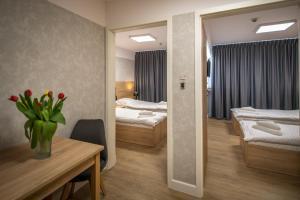 Łóżko lub łóżka w pokoju w obiekcie Jubilat