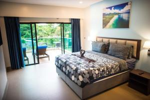 A bed or beds in a room at The Pearl Luxury Pool Villas