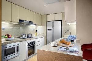 مطبخ أو مطبخ صغير في Hilton Guangzhou Science City