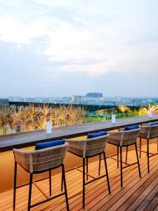 A balcony or terrace at Artotel Gajahmada Semarang