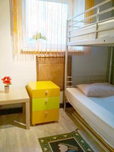 Кровать или кровати в номере Moscow Friends Hostel