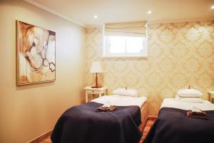 Säng eller sängar i ett rum på 5:ans Bed & Breakfast
