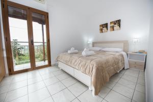 Ένα ή περισσότερα κρεβάτια σε δωμάτιο στο Irene Komos