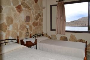 A bed or beds in a room at Athena Rooms