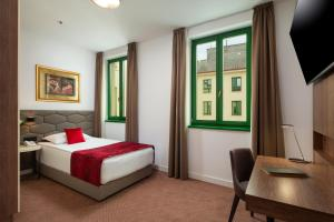 A bed or beds in a room at Hotel Park 45
