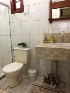 A bathroom at Hospedaria Aconchego