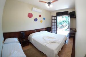 Cama ou camas em um quarto em Vale do Sonho Hotel