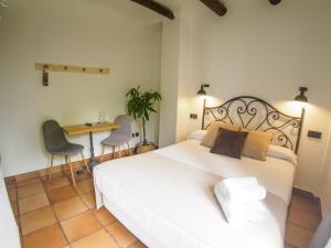 A bed or beds in a room at El Balcon de las Nieves