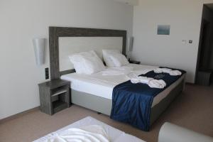 A bed or beds in a room at Moonlight Hotel - All Inclusive