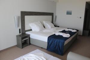Кровать или кровати в номере Moonlight Hotel - All Inclusive