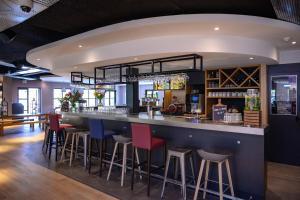 Lounge alebo bar v ubytovaní Campanile Hotel & Restaurant Eindhoven