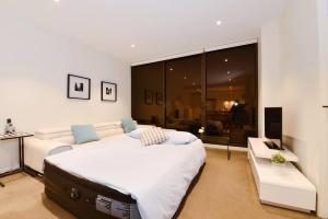 A bed or beds in a room at 22*Latte Time@1BR1BTH*Mel CBD*Free Tram