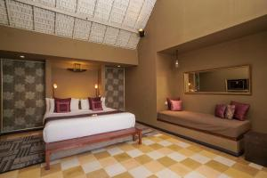 A bed or beds in a room at Space Villas Bali