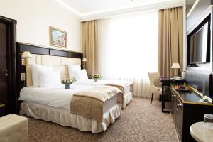 Ein Bett oder Betten in einem Zimmer der Unterkunft 7 Avenue Hotel and SPA