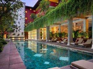 The swimming pool at or near Amnaya Resort Kuta