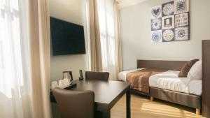 Cama o camas de una habitación en Hotel Nes